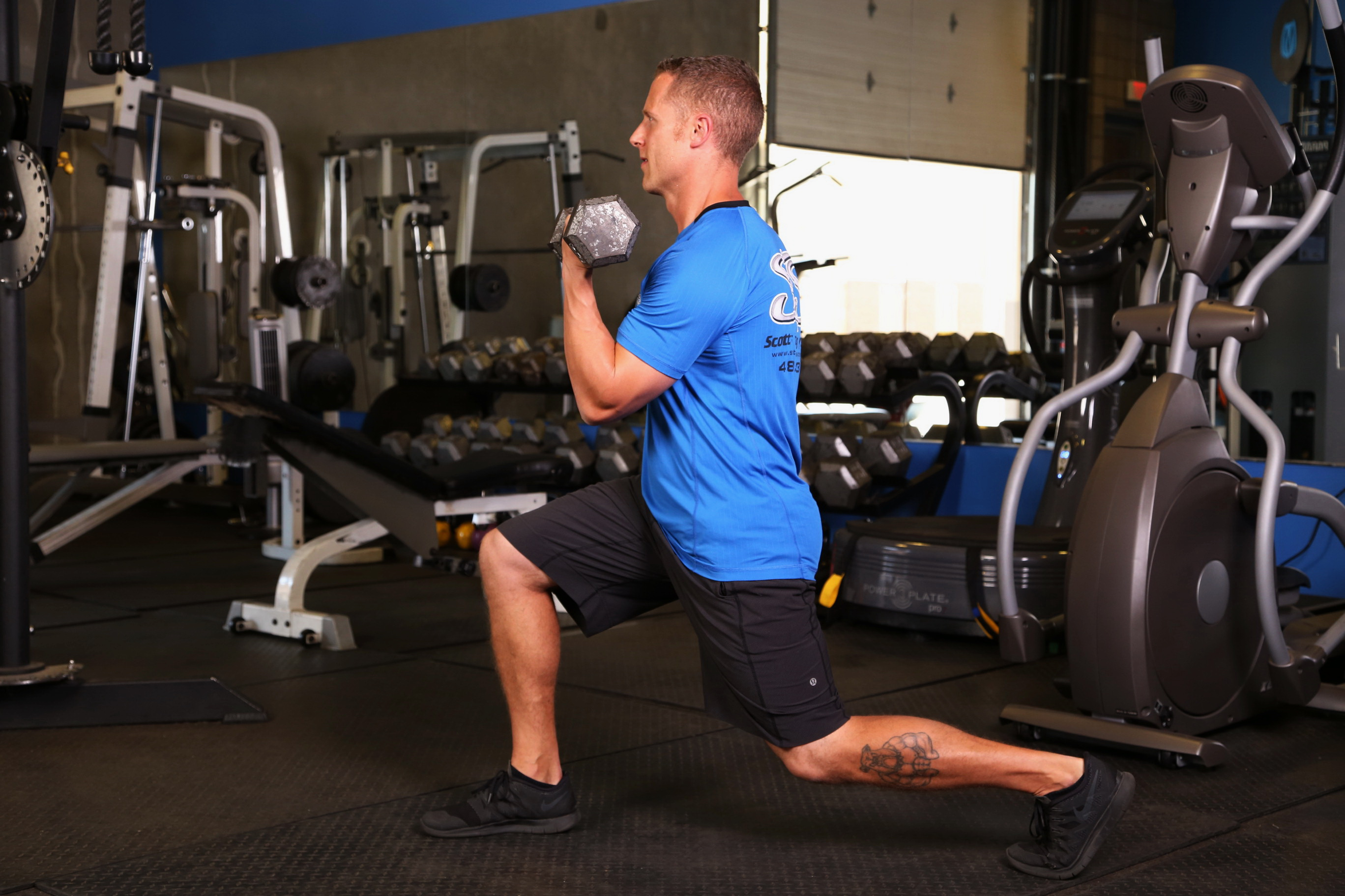 Reverse Lunge with Curl to Press